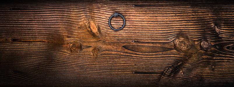 brown wooden board with door knocker