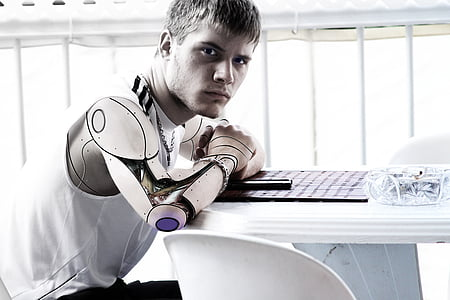 man with robotic arm photo