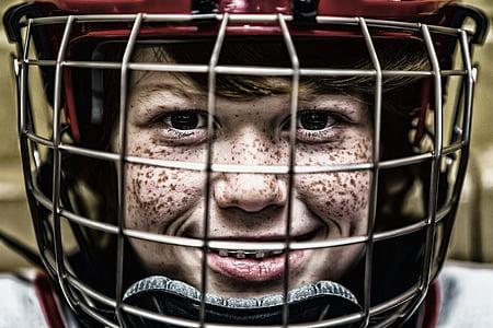 boy in black and red helmet