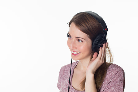 smiling woman with headphones on