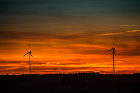 photo of silhouette two windmills