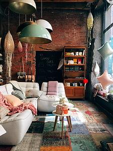 assorted-color pendant lamp near white fabric sofa
