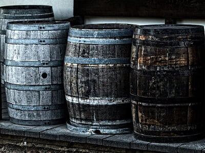 four gray wooden barrels