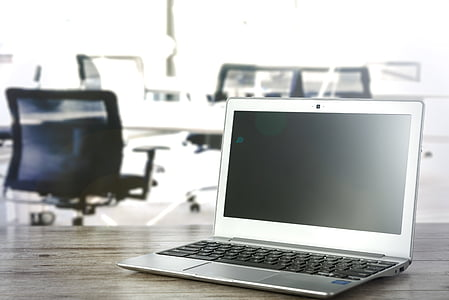 silver laptop computer on desk