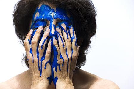 person make face blue paint