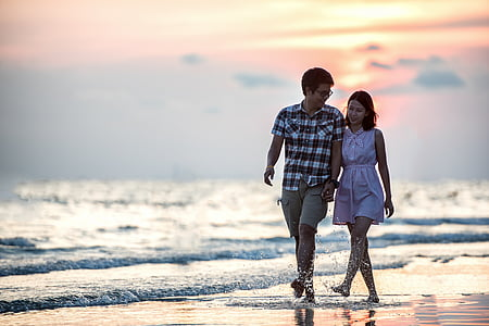 couple man and woman walking in seashore