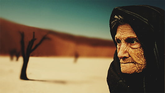 selective focus photography of woman wearing black hijab