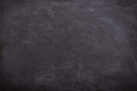 chalk traces on blackboard
