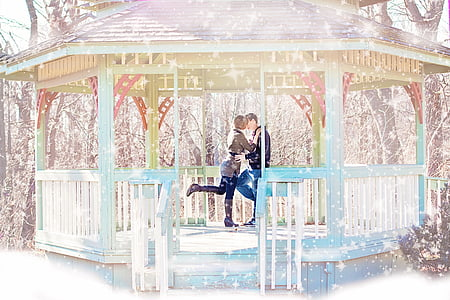couple kissing inside gazebo