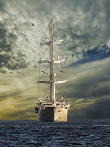 white ship sailing during cloudy day