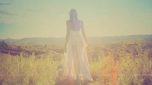 woman wearing white dress on grass field