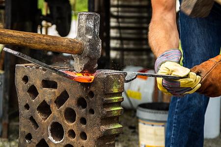 man holding forging iron