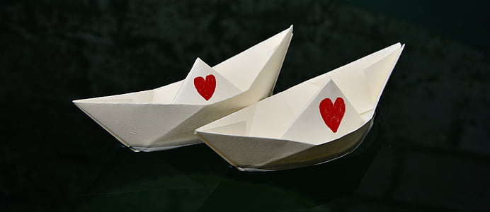 two white paper boats