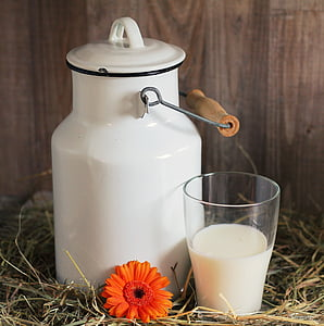 white milk can and drinking glass