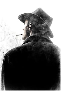grayscale photography of man with black cowboy hat