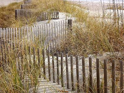brown wooden fence near green grass fields