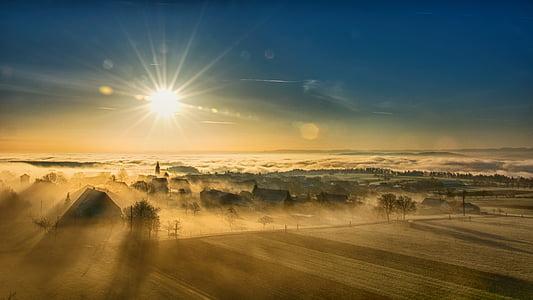 aerial photo of farm during dawn