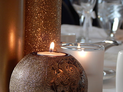 closeup photo of two lit candles