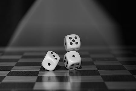 grayscale photo of three dices