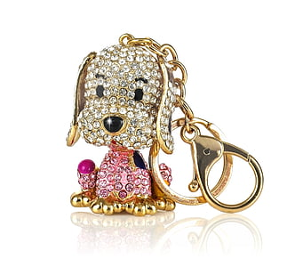 gold-colored clear and pink gemstone dog keychain