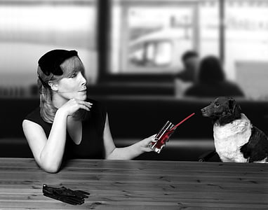 grayscale photo of woman and dog