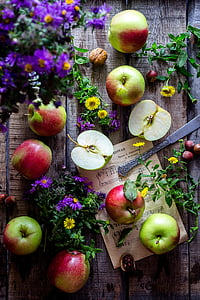 apples and flowers on table