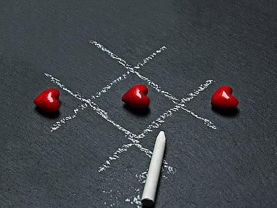 three heart-shape red ornaments