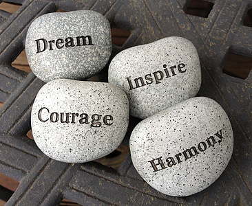 four gray Dream, Inspire, Courage, and Harmony stones