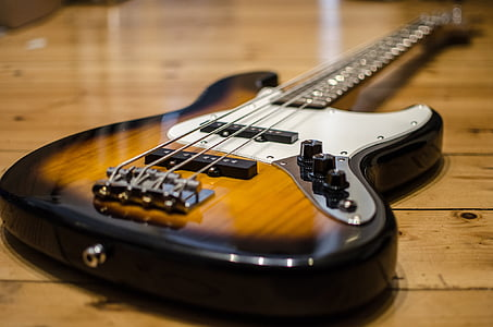 black, brown, and white 4-string bass guitar
