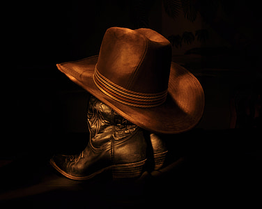 brown cowboy hat on black boots