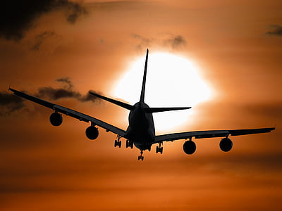 silhouette photo of plane during golden hour