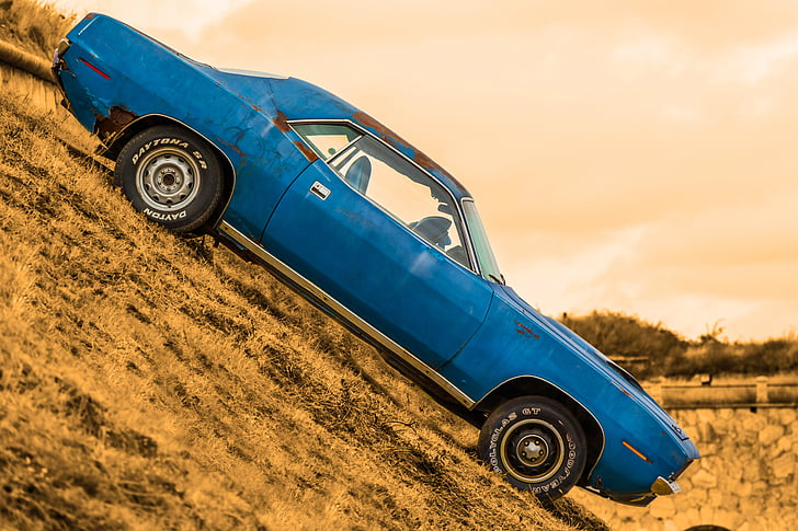 selective photo of blue muscle car during daytime