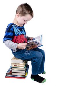 boy sitting reading book