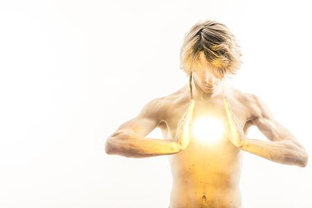 man with blonde hair focusing energy