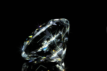 photo of clear gemstone in black background