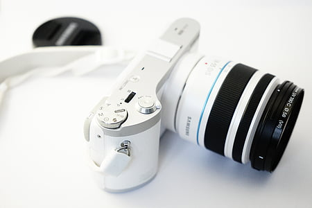 white Samsung point-and-shoot camera